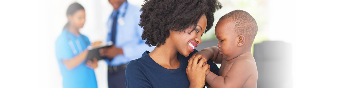 bigstock-stock-photo-african-mother-playing-with-her-baby-boy-in-doctor-s-office-waiting-to-do-checkup